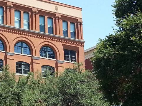 A close-up of the sixth floor window of the former Texas School Book Depository where it is alleged that Oswald fired the shots from.