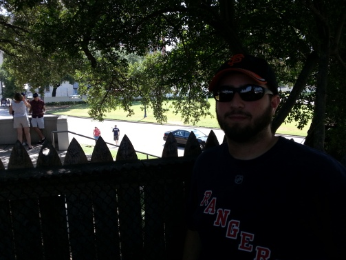 Me standing at the corner of the picket fence up on the Grassy Knoll, where many theorists insist mob hit-man James Files fired the fatal head-shot.