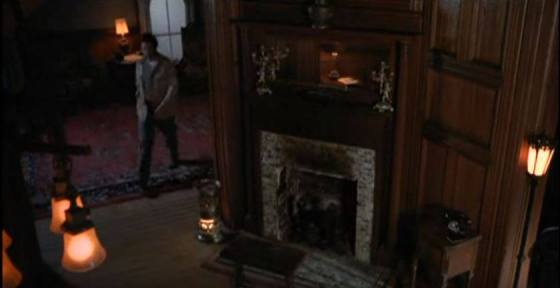 The foyer, which is the focal point of the house because of its woodwork. Nearly unchanged since filming except for light fixtures.